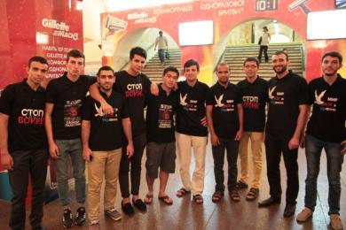 """شباب """"الرائد"""" و""""فلاش موب"""" للتعريف بالعدوان الإسرائيلي على غزة"""